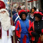 "Saint Nicholas is followed by his two assistants called ""Zwarte Piet"" during a traditional parade in central Brussels"