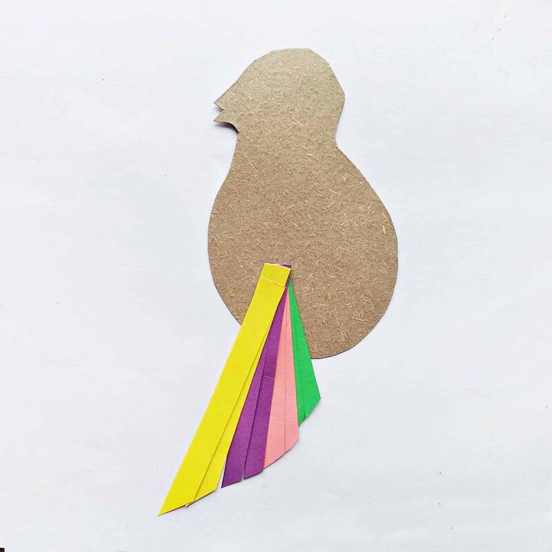 Как сделать с детьми птичку из полосок бумаги?